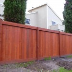 New stained redwood fence