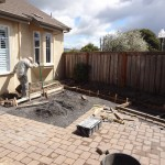 Paver patio extension being installed