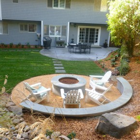 Firepit with curved seat wall