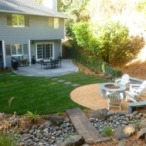 New lawn, patio, firepit, and plank bridge over streambed