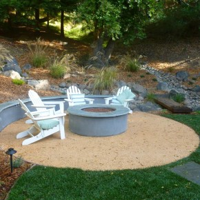 Compacted gravel seating area and concrete firepit