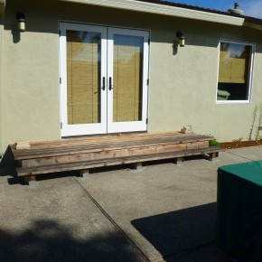Before- existing landing and concrete patio