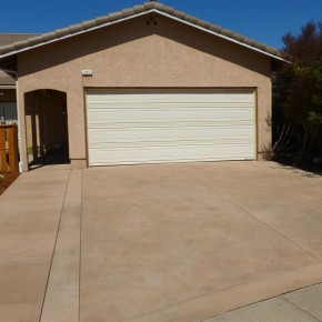 After- New colored concrete driveway