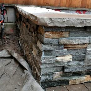 Seat wall stone veneer detail
