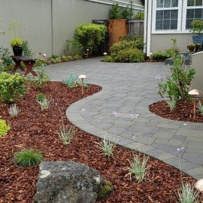 Low maintenance plantings with accent boulders